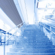 Blue moving escalator in the office hall perspective view — Stock Photo
