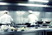 Motion chefs of a restaurant kitchen — Stock Photo