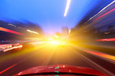 Car driving fast down in the city — Stockfoto