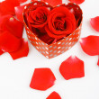 Red rose and a gift box - Stock Photo