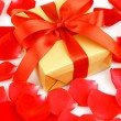 Stock Photo: Red rose and a gift box