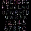 Light painting photograph of the alphabet and numbers 1 to 9 — Stock Photo #19365763