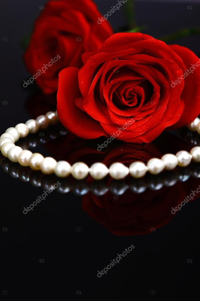 Beautiful red rose with necklace — Stock Photo #19361551