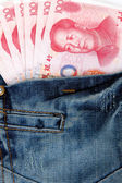 Jeans texture chinese RMB cash background — Stock Photo