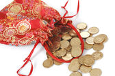 Red bags full of golden coins. isolated on white. — Stock Photo