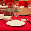 Fine restaurant dinner table place setting: napkin & wineglass — Stock Photo