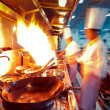 Motion chefs of a restaurant kitchen — Stock Photo #19424637