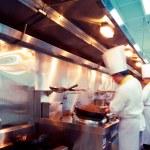 Motion chefs of a restaurant kitchen — Stock Photo #19424951