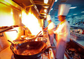Motion chefs of a restaurant kitchen — ストック写真