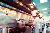 Motion chefs of a restaurant kitchen — Stock Photo