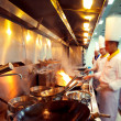 Motion chefs of a restaurant kitchen — Stock Photo #20064979