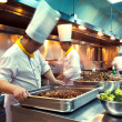 Motion chefs of a restaurant kitchen — Stock Photo #20064983
