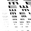 Eyesight test chart on white background close-up - Stock Photo