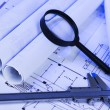 Magnifying glass and blueprint - Foto Stock