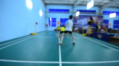 Badminton courts with players competing in indoor. — Stock Video