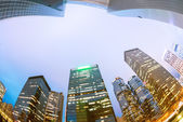 The light trails on the modern building background in hongkong c — Foto Stock