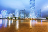 The light trails on the modern building background in hongkong c — Stock Photo