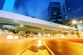 The light trails on the modern building background in shanghai china — Stock Photo