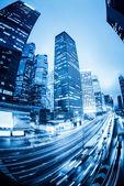 Traffic with blur light through city at night — Stock Photo