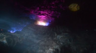 Laser color line stage spotlight shone on the rock wall — Stock Video
