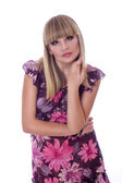 Portrait of a beautiful young blonde woman with professional makeup short black transparent dress with lilac flowers. — Stock Photo