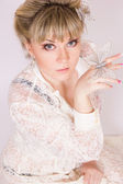Portrait of a beautiful young blonde woman in sexy lace blouse. — Stock Photo