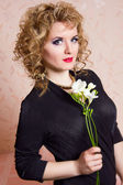 Portrait of a beautiful young blonde woman in a retro style. Girl dressed in a black bodysuit, shows emotion — Stock Photo