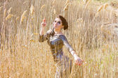 Young pretty brunette woman posing outdoor in summer meadow. Sensual girl posing in park — Stok fotoğraf