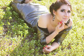 Luxury woman in a long black evening dress in the park — Stok fotoğraf