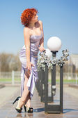 Gorgeous red-haired woman on a walk in the park. Young girl on the nature — Stock Photo