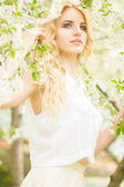 Spring portrait of a beautiful young blonde woman. — ストック写真