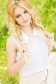 Spring portrait of a beautiful young blonde woman. — Stock Photo