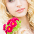 Portrait of a beautiful young blonde woman on a sunny summer day — Stock Photo #46119639