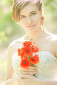 Beautiful bride outdoors - soft focus — Stock Photo
