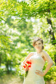Beautiful bride outdoors - soft focus — Stock Photo