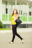 Young attractive woman with bag — Stock Photo