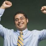 Hispanic businessman cheering — Stock Photo #13225294