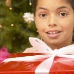 Hispanic boy with Christmas gift — Stock Photo #13227449