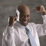 African businessman cheering — Stock Photo #13227507