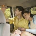 Woman resting against boyfriend on road trip — Stock Photo #13229564