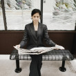Businesswoman reading a newspaper — Foto de Stock