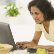 Woman typing on laptop — Stock Photo