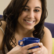 Native Americwomholding coffee cup — Stockfoto #13220681