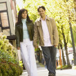 Hispanic couple walking on sidewalk — Stock Photo