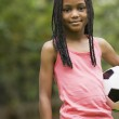 African girl holding soccer ball — Stock Photo #13220691