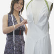 Dressmaker sewing on mannequin — Stock Photo