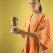 Portrait of girl holding chalice - Stock Photo