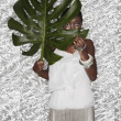 Portrait of African woman holding Monstera leaf — Stock Photo #13220824