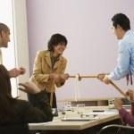 Businesspeople playing tug of war — Stock Photo #13220852