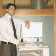 Stock Photo: Businessmusing copy machine